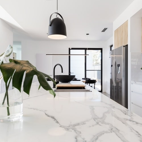 Kitchen,Marble,Bench,Close,Up,With,Black,Hanging,Pendant,And
